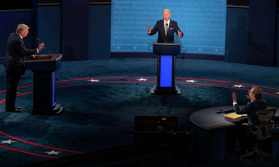 President Donald Trump, Joe Biden, and debate moderator Chris Wallace, all gestures during the first scheduled presidential debate, Tuesday, Sept. 29, 2020, at Case Western Reserve University in Cleveland. (Ruth Fremson/The New York Times) Photo: RUTH FREMSON, STF / NYT / NYTNS