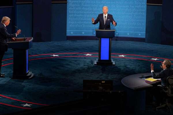 President Donald Trump, Joe Biden, and debate moderator Chris Wallace, all gestures during the first scheduled presidential debate, Tuesday, Sept. 29, 2020, at Case Western Reserve University in Cleveland. (Ruth Fremson/The New York Times)
