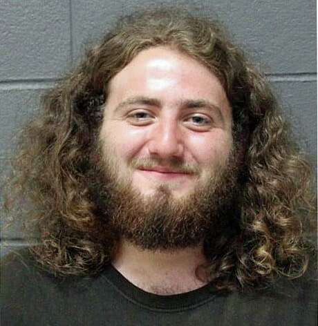 """Southington police said they used a """"less lethal"""" bean bag shot to take a 21-year-old man into custody after he allegedly broke into his father's house and stole $1,300 in cash on Wednesday, Sept. 20, 2020. Connor Trasinski was charged with second-degree burglary, fourth-degree larceny, violation of a protective order, interfering with an officer, breach of peace, reckless endangerment, negligent use of a highway by a pedestrian and assault on a public safety officer. Photo: Southington Police Photo"""
