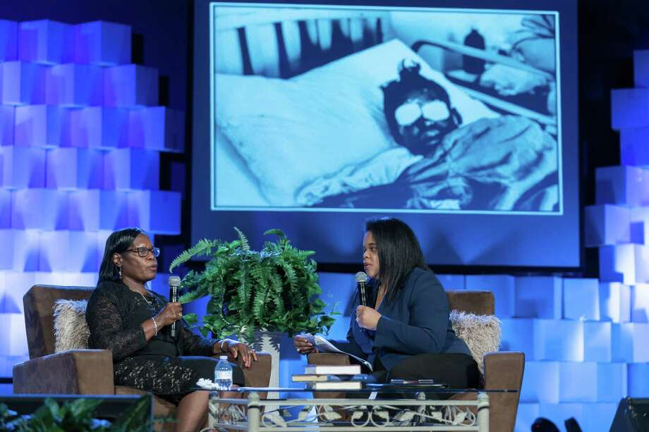 With a photo of her injured in a hospital room on the screen behind her, Sarah Collins Rudolph, left, speaks in February in Decatur, Ga., with Ebony Phillips about the 16th Street Baptist Church bombing. Photo: Photo For The Washington Post By Michael A. Schwarz / Michael A. Schwarz