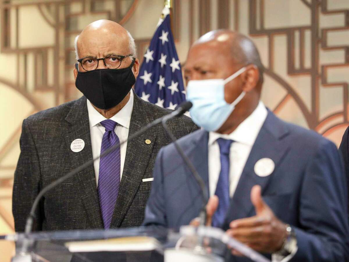 Chairman Larry Payne listens as Houston Mayor Sylvester Turner speaks during a press conference to announce the recommendations of the Mayor's Task Force on Policing Reform on Wednesday, Sept. 30 2020, at city hall in Houston.
