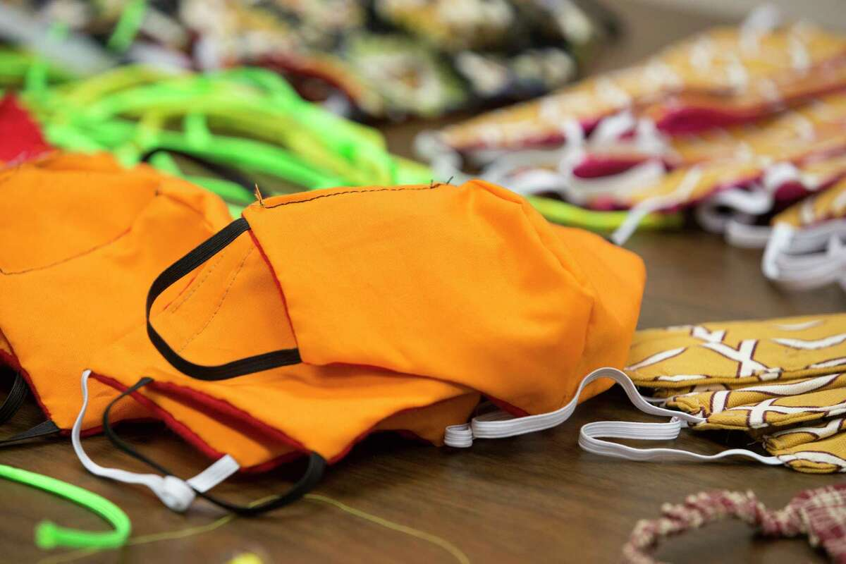 Sample of cloth masks made by Fort Bend County Jail inmates are on display Thursday, April 9, 2020, in Richmond. Fort Bend ISD requires masks to be worn by students and faculty to help curtail the spread of COVID-19.