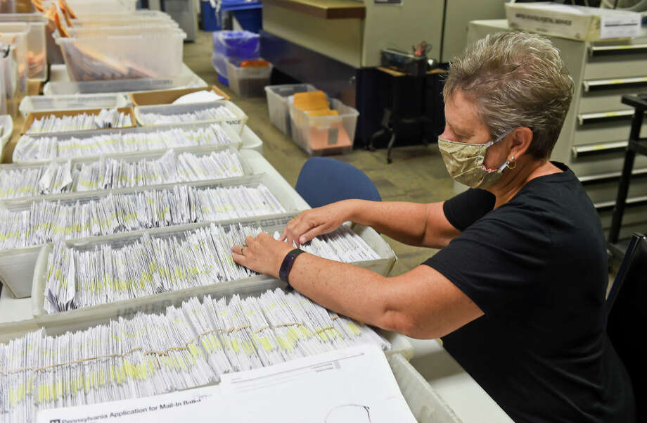 Donna Blatt looks over applications for mail-in ballots. Photo: MediaNews Group / Copyright - 2020 Image MediaNews Group