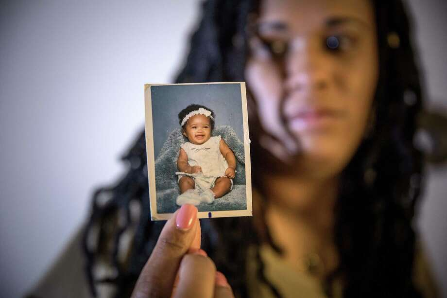 Brandy Billie-Moore holds a baby photo of her daughter Ashanti, who was killed in 2017 at age 19. Photo: Photo For The Washington Post By Evelyn Hockstein / Evelyn Hockstein