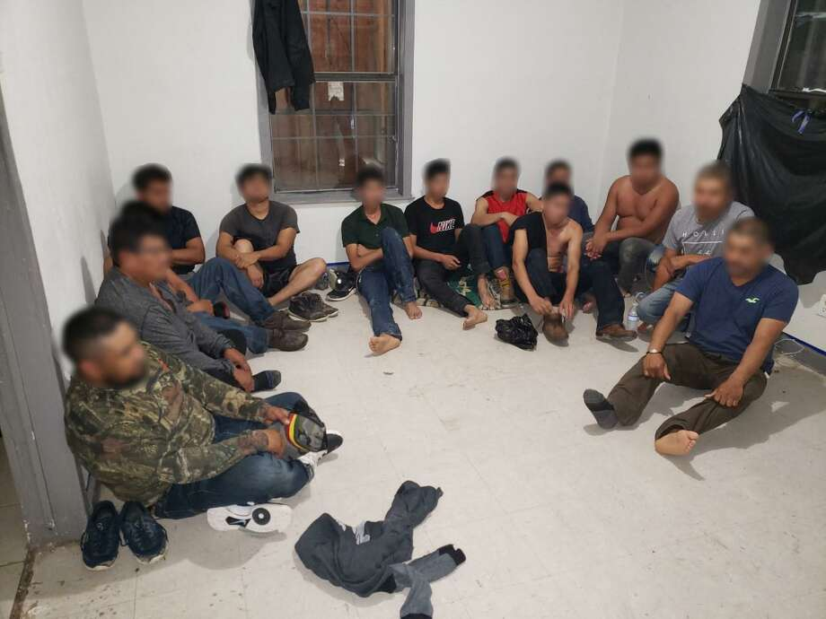 Federal and local authorities found these 13 people inside a home on Sanchez Street. All were determined to be immigrants who had crossed the border illegally. Photo: Courtesy Photo /U.S. Border Patrol