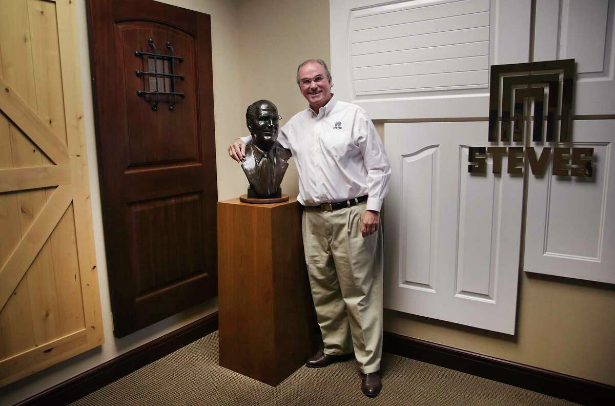 Sam Steves, president and COO, with a sculpture of his father, Marshall T. Steves, whom he credits for the success of the company.