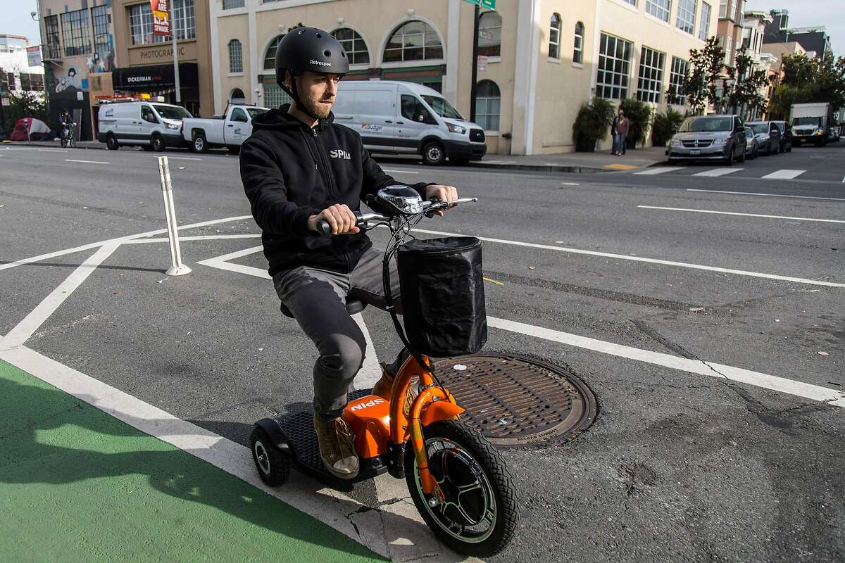Nate Chamness shows how the new three-wheeled accessibility scooter at Spin takes the streets on Wednesday, Jan. 15, 2020 in San Francisco. Spin workers voted to ratify a union contract this week.