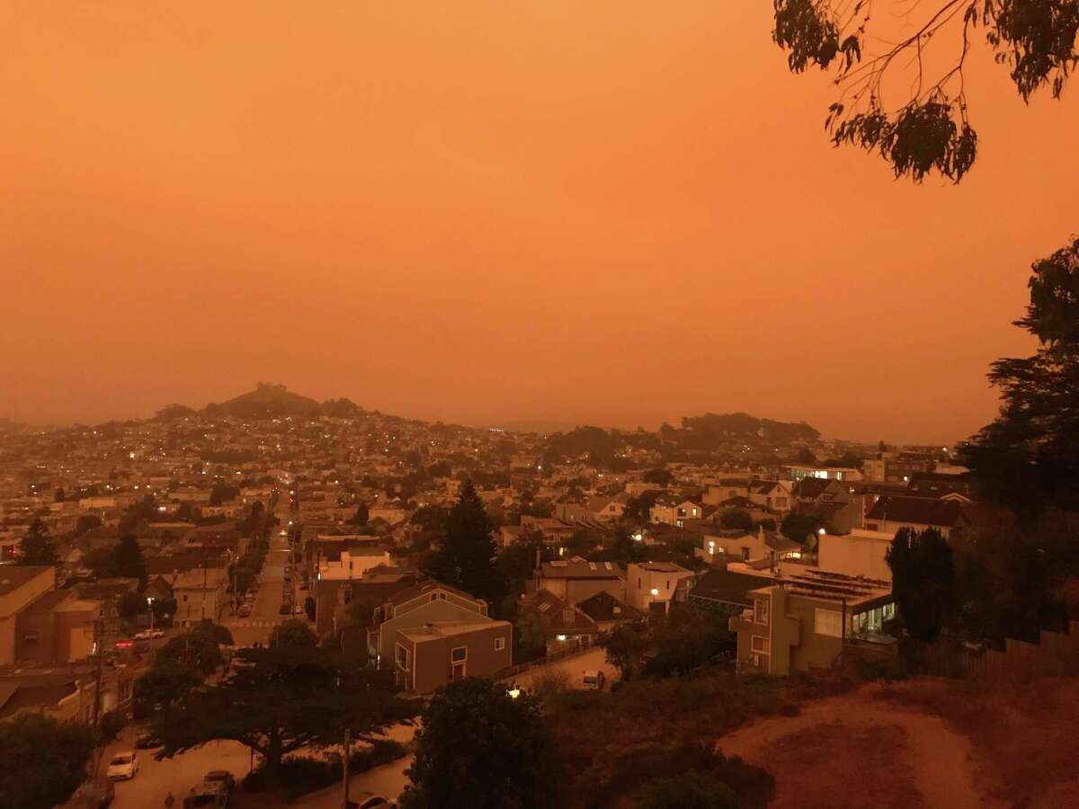 Air quality is expected to plummet in the next few days as smoke from the Glass Fire coats the Bay Area. San Francisco was bathed in a choking orange glow from wildfire smoke on Sept. 9, seen from Billy Goat Hill Park.