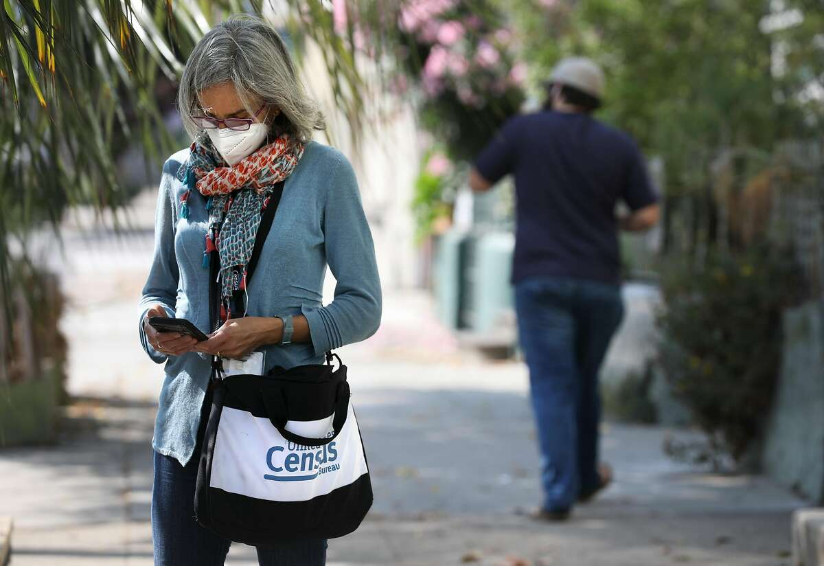 Census enumerator Amy Tanner checks her phone on San Jose Avenue in San Francisco on Sept. 17.