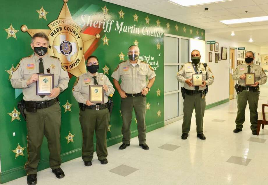 Sheriff Martin Cuellar bid farewell to four members of the Webb County Sheriff's Office who retired on Wednesday. Photo: Courtesy Photo /Webb County Sheriff's Office