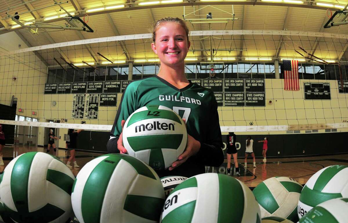 Guilford volleyball player Emma Appleman poses at the school in Guilford, Conn., on Tuesday Sept. 29, 2020. Appleman, is arguably the best player in the state, and is the daughter of Yale volleyball coach Erin Appleman.