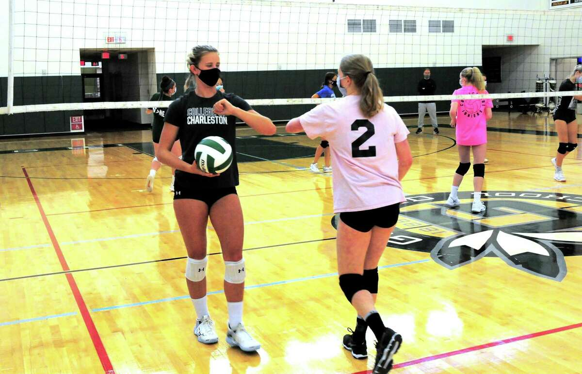 Guilford volleyball player Emma Appleman, left, during practice at the school in Guilford, Conn., on Tuesday Sept. 29, 2020. Appleman, is arguably the best player in the state, and is the daughter of Yale volleyball coach Erin Appleman.