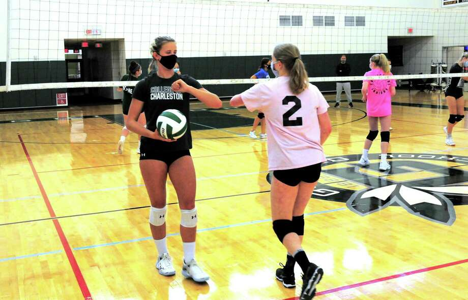 Guilford volleyball player Emma Appleman, left, during practice at the school in Guilford, Conn., on Tuesday Sept. 29, 2020. Appleman, is arguably the best player in the state, and is the daughter of Yale volleyball coach Erin Appleman. Photo: Christian Abraham / Hearst Connecticut Media / Connecticut Post