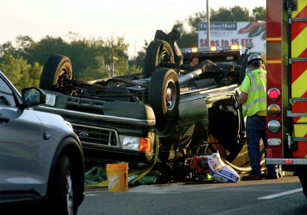A vehicle sits on its roof after a crash in the southbound lane on I95 near exit 30 in Stratford, Conn., on Wednesday Sept. 30, 2020. Traffic was backed up six miles into Milford.