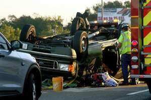 A vehicle sits on its roof after a crash in the southbound lane on I-95 near Exit 30 in Stratford, Conn., on Wednesday Sept. 30, 2020. Traffic was backed up at least six miles into Milford.