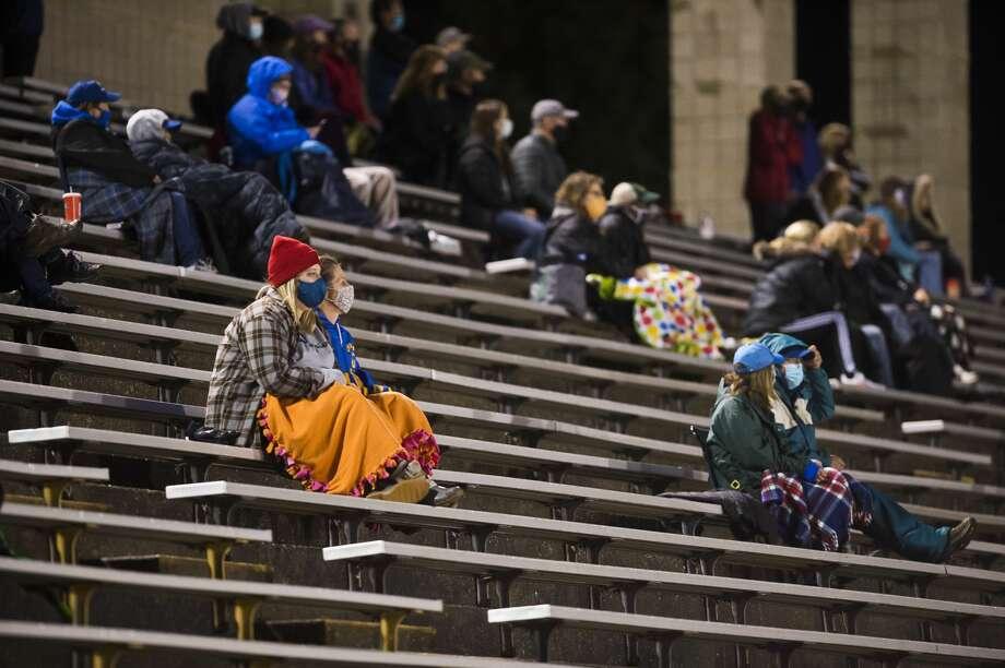 Fans watch as Midland and Dow face off in varsity soccer Wednesday, Sept. 30, 2020 at Midland Community Stadium. (Katy Kildee/kkildee@mdn.net) Photo: (Katy Kildee/kkildee@mdn.net)