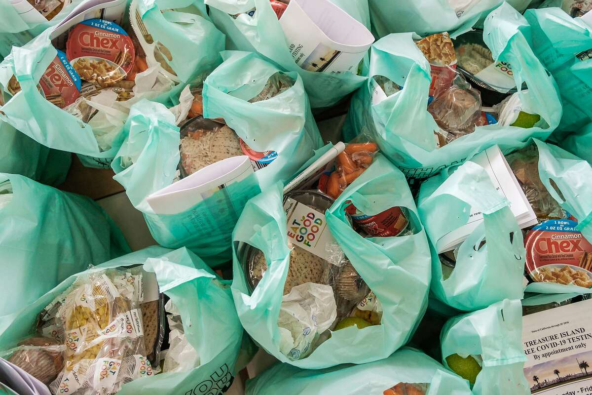 Student meals and groceries are seen bagged before being delivered to island residents on Treasure Island on Friday September 11, 2020. The food program is being done by the San Francisco Unified School District.