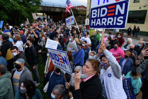 Supporters gather outside the Amtrak station in Latrobe, Pa., for a glimpse of former vice president Joe Biden as he stops during a train tour through parts of Ohio and Pennsylvania on Wednesday.