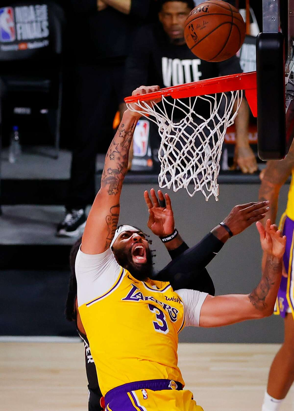 Lakers forward Anthony Davis is fouled during the fourth quarter against the Heat. He scored 34 points.