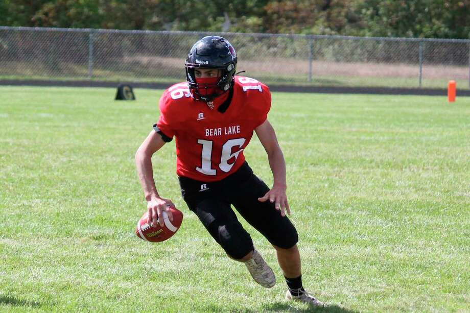 Bryce Harless scrambles during the Lakers' season opener against Ashley on Sept. 19. Through two games, he is the team's leading rusher. (File photo)