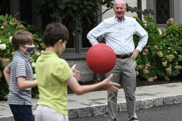 New Interim Head of School Jim Heus watches over students during recess at Eagle Hill School in Greenwich, Conn. Wednesday, Sept. 30, 2020.