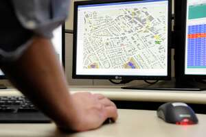 A file photo of a vehicle location system in the 911 dispatch center in Danbury, Conn.