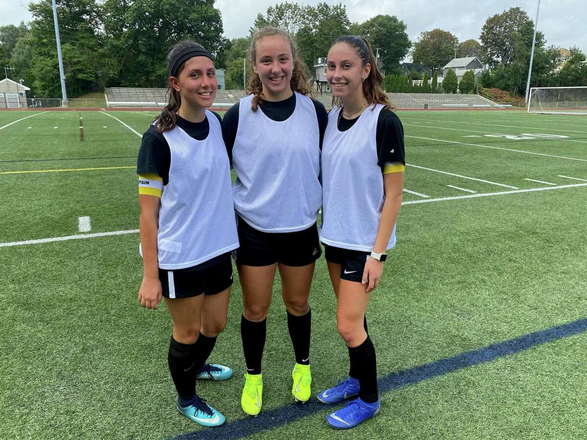 Alexis Voytek, Shelby Green, and Andriana Bruno are Law girls' soccer captains