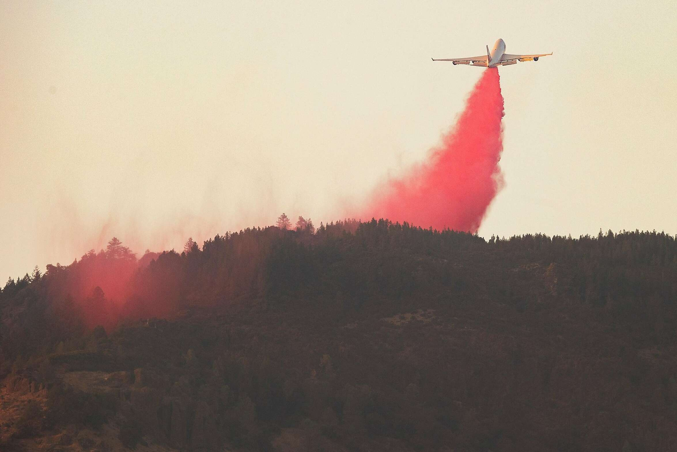 Boeing 747-446(BCF) releases fire retardant in an attempt to prevent the Glass Fire from reaching homes along Old Lawley Toll Road and from reaching Highway 29, Wednesday, Sept. 30, 2020, in Calistoga, Calif.