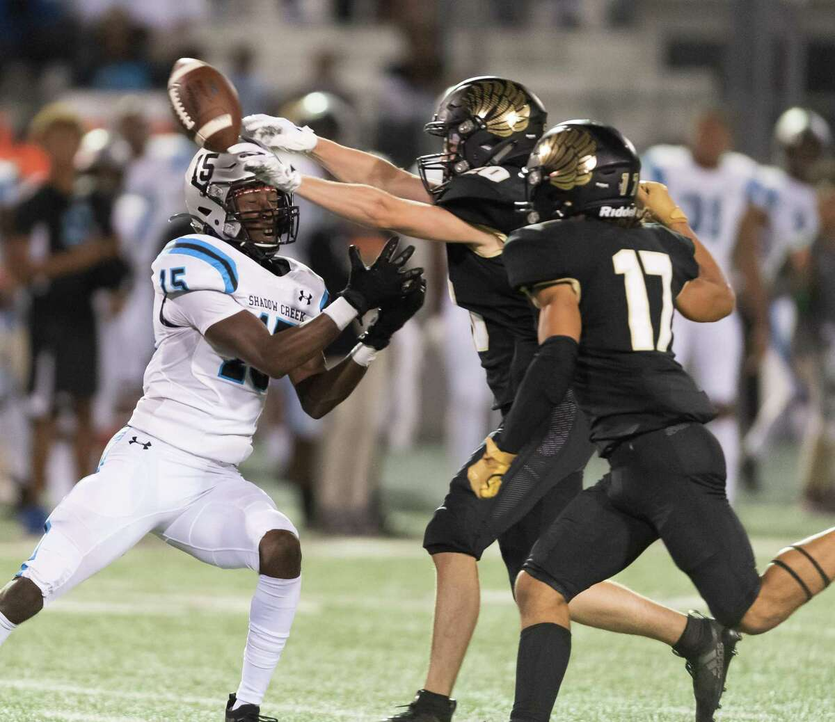 Ethan Kappes (20) of the Foster Falcons breaks up a pass to Jared Jackson (15) of the Shadow Creek Sharks in the second half in a high school football game on Thursday, October 24, 2019 at Traylor Stadium in Rosenberg Texas.