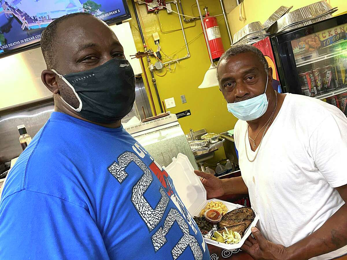 David Lewis, left, and Robert Stewart run King Lou's Soul Food & BBQ inside the First Stop Food Store on East Houston Street.