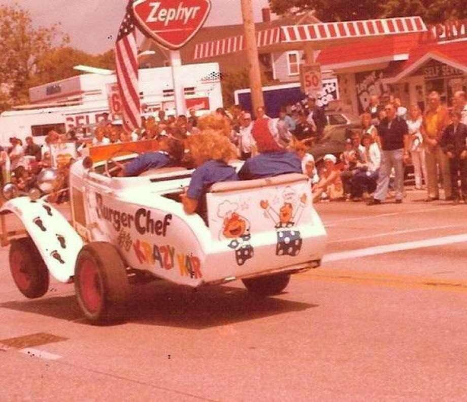 """This early 1970s era photograph from a Fourth of July parade shows a """"Krazy Kar"""" entry from the fast food restaurant Burger Chef."""