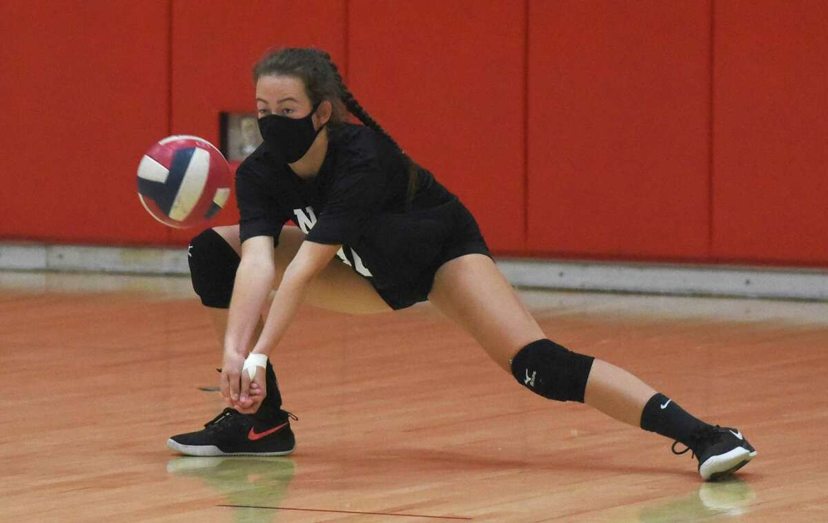 New Canaan senior co-captain Alex Gillespie gets low for a dig during a preseason volleyball practice at NCHS on Friday, Sept. 25, 2020.