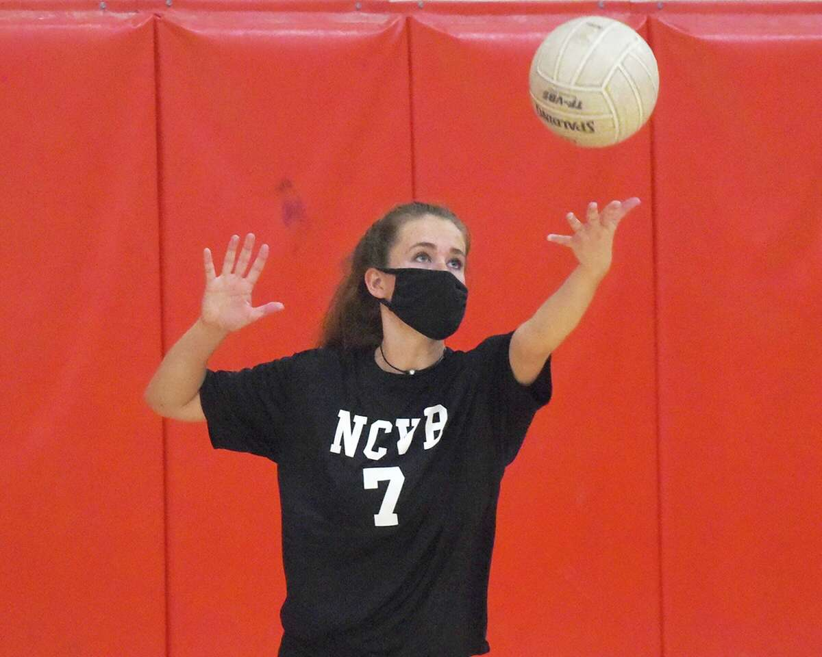 New Canaan senior co-captain Annie Gravereaux gets set to serve during a preseason volleyball practice at NCHS on Friday, Sept. 25.