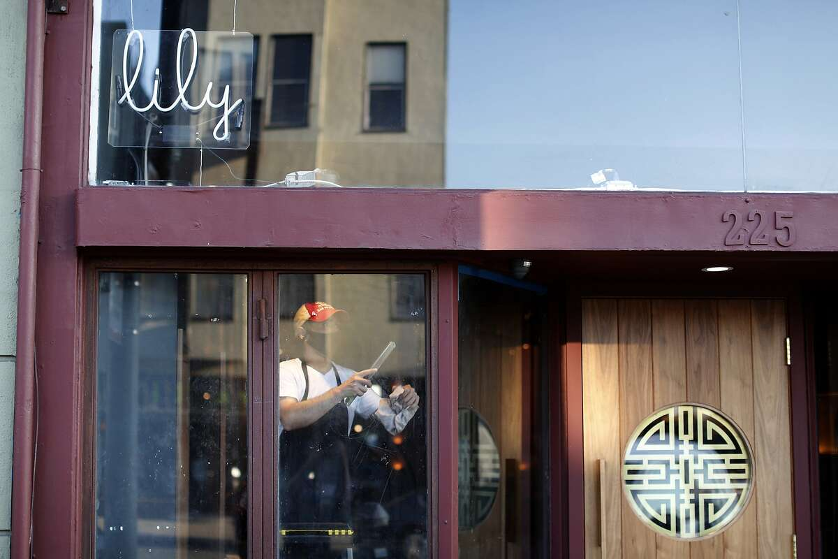 Employees get San Francisco restaurant Lily ready a day before its Oct. 1 opening.
