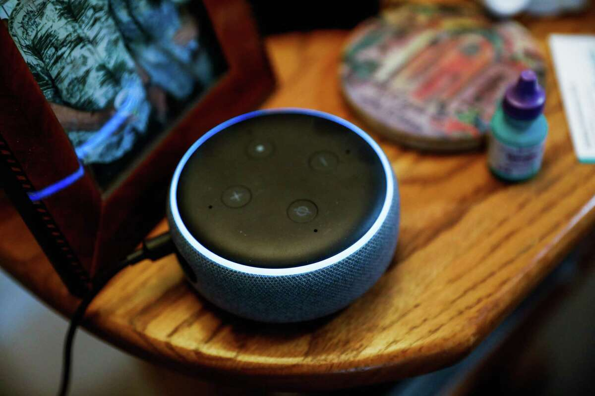 Virtual AI assistant Alexa sits on a nightstand in his room at the Sunny View Bay Area Retirement Center on Wednesday, Feb. 12, 2020 in Cupertino, California. Several companies around the world are developing protocols through which Alexa, for example, might be able to tell if you have a disease, as the journal Nature reported. One such company, Vocalis, has already built an app for your smartphone that detects COPD and asthma by listening for shortness of breath. Vocalis then fed 1,500 voice samples of people with confirmed COVID-19 into the same AI engine and, lo and behold ... they're still testing it. But it's promising, within limitations. It's not intended to actually diagnose a COVID infection but provide some context to doctors during triage.