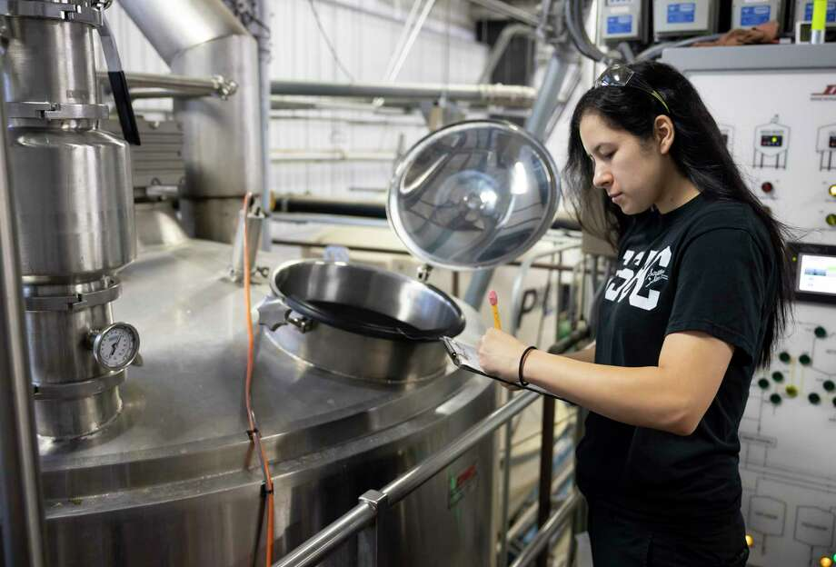 Michelle Ramirez looks over paperwork at Southern Star Brewery in Conroe, Friday, Sept. 25, 2020. Ramirez officially became a brewer two years ago after her mother asked Southern Star if they were hiring. Photo: Gustavo Huerta, Houston Chronicle / Staff Photographer / 2020 © Houston Chronicle
