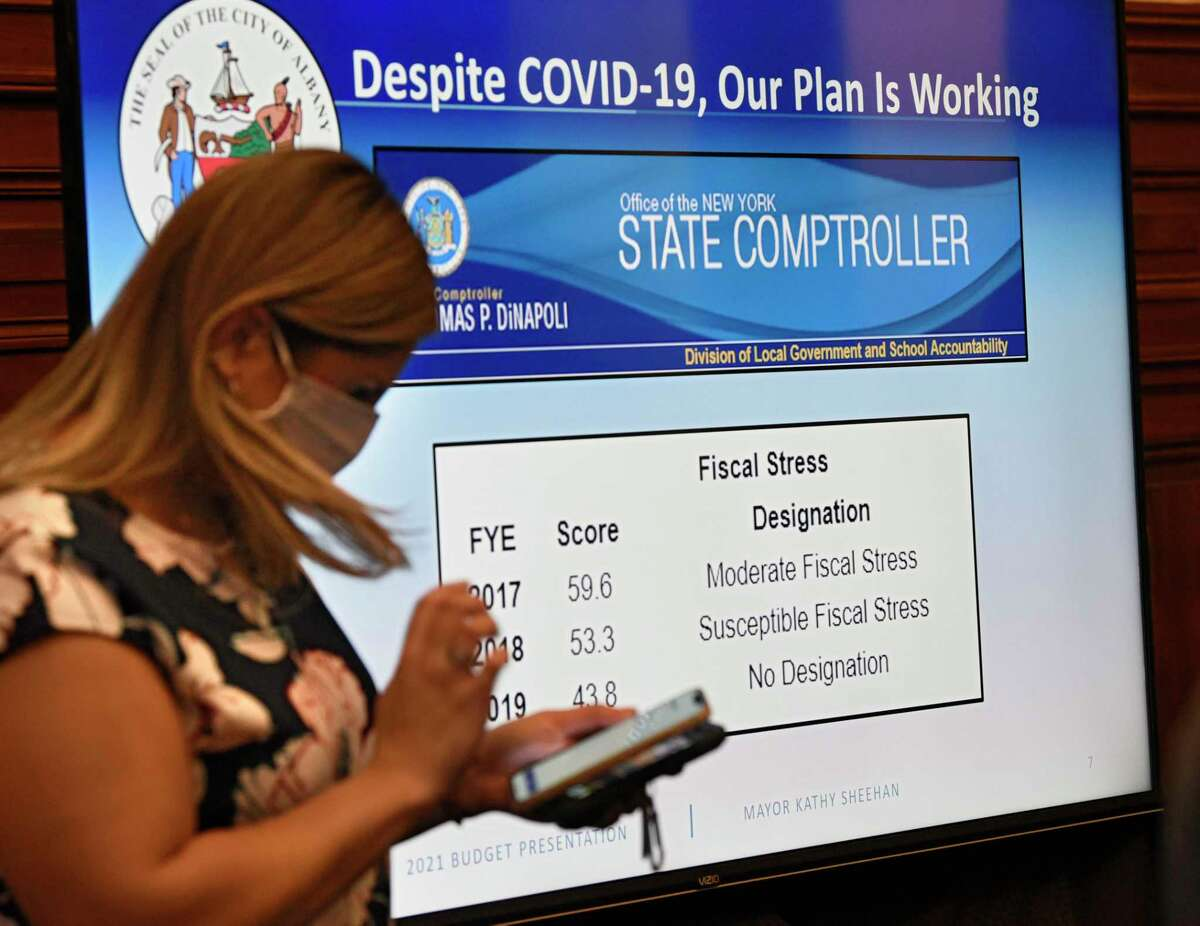 A slide presentation is seen on a screen during Mayor Kathy Sheehan's presentation her 2021 proposed city budget at City Hall on Thursday, Oct. 1, 2020 in Albany, N.Y. (Lori Van Buren/Times Union)