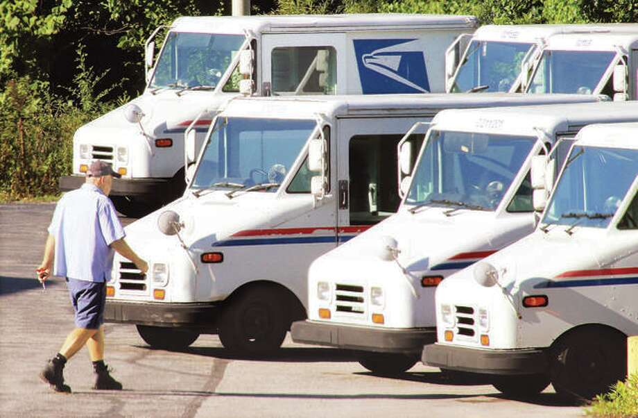 An Alton letter carrier picks up his vehicle behind the main Alton Post Office on the Homer Adams Parkway back in August. Photo: John Badman | Hearst Newspapers