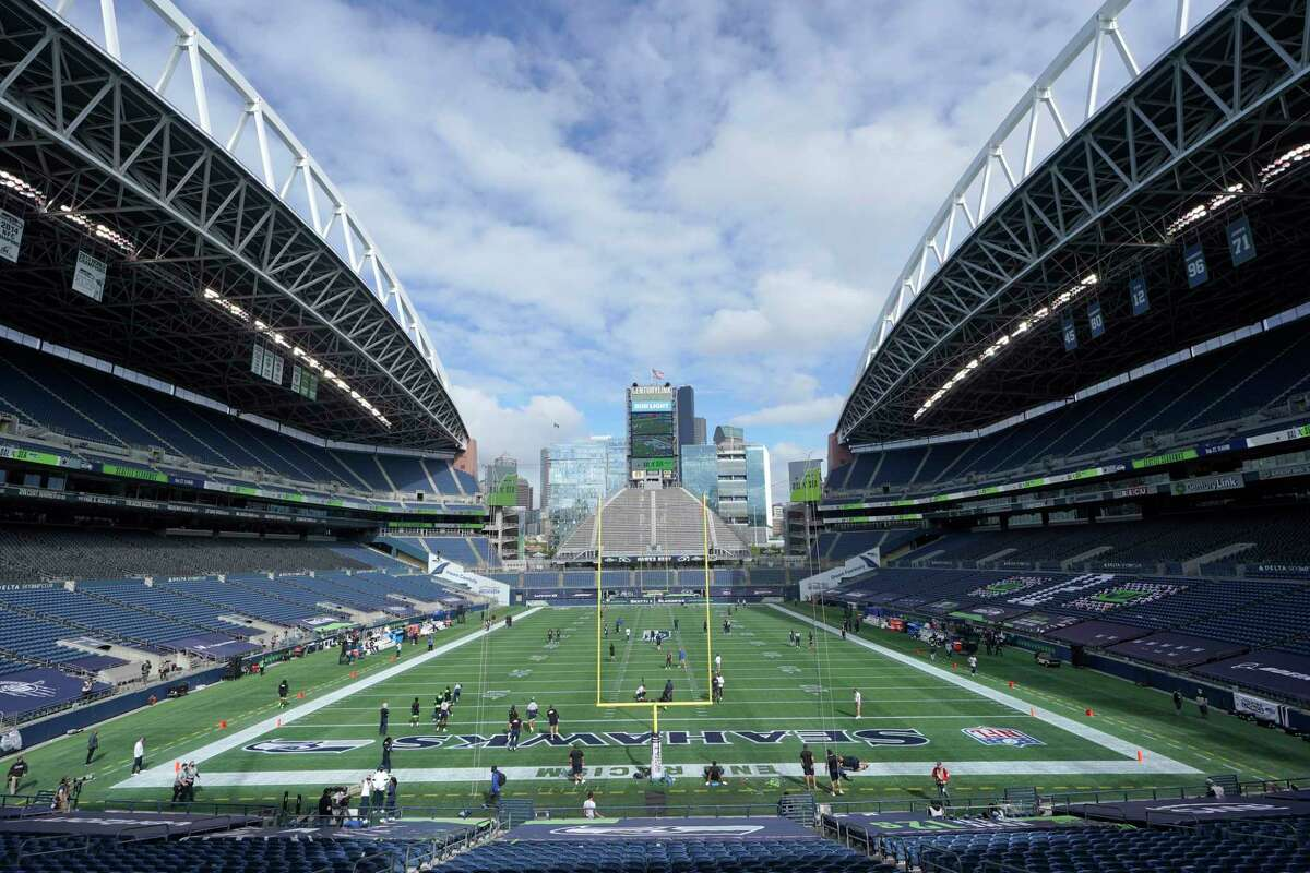 CenturyLink Field is shown as the Seattle Seahawks and the Dallas Cowboys warm up before an NFL football game, Sunday, Sept. 27, 2020, in Seattle.