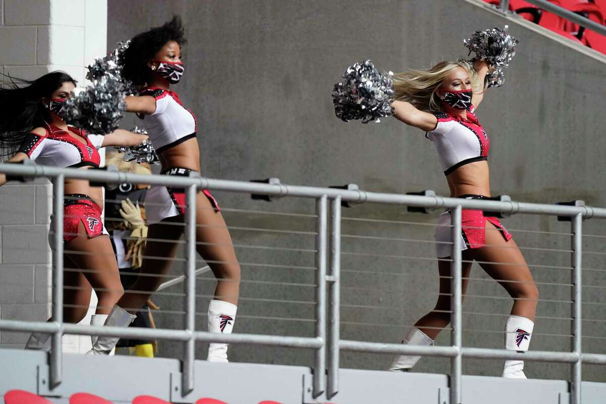 Atlanta Falcons cheerleaders perfrom before the first half of an NFL football game between the Atlanta Falcons and the Chicago Bears, Sunday, Sept. 27, 2020, in Atlanta. (AP Photo/Brynn Anderson)