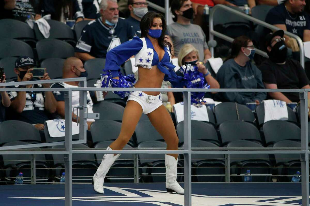 A member of the Dallas Cowboys Cheerleaders performs during the first half of an NFL football game against the Atlanta Falcons in Arlington, Texas, Sunday, Sept. 20, 2020. (AP Photo/Michael Ainsworth)