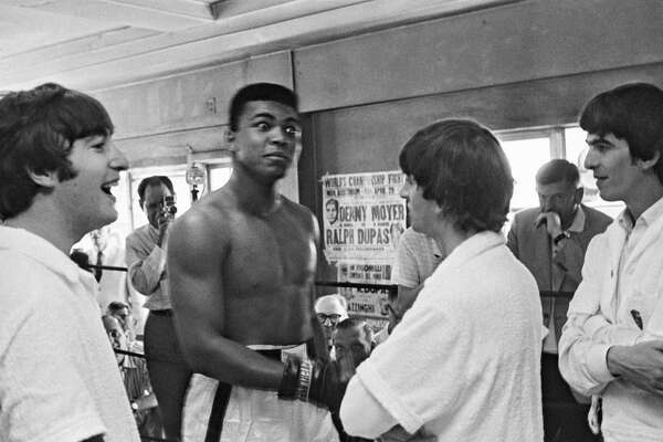 Boxer Cassius Clay (later Muhammad Ali) meets (from left) John Lennon (1940-1980), Ringo Starr and George Harrison (1943-2001) at his training centre in Miami in 1964.