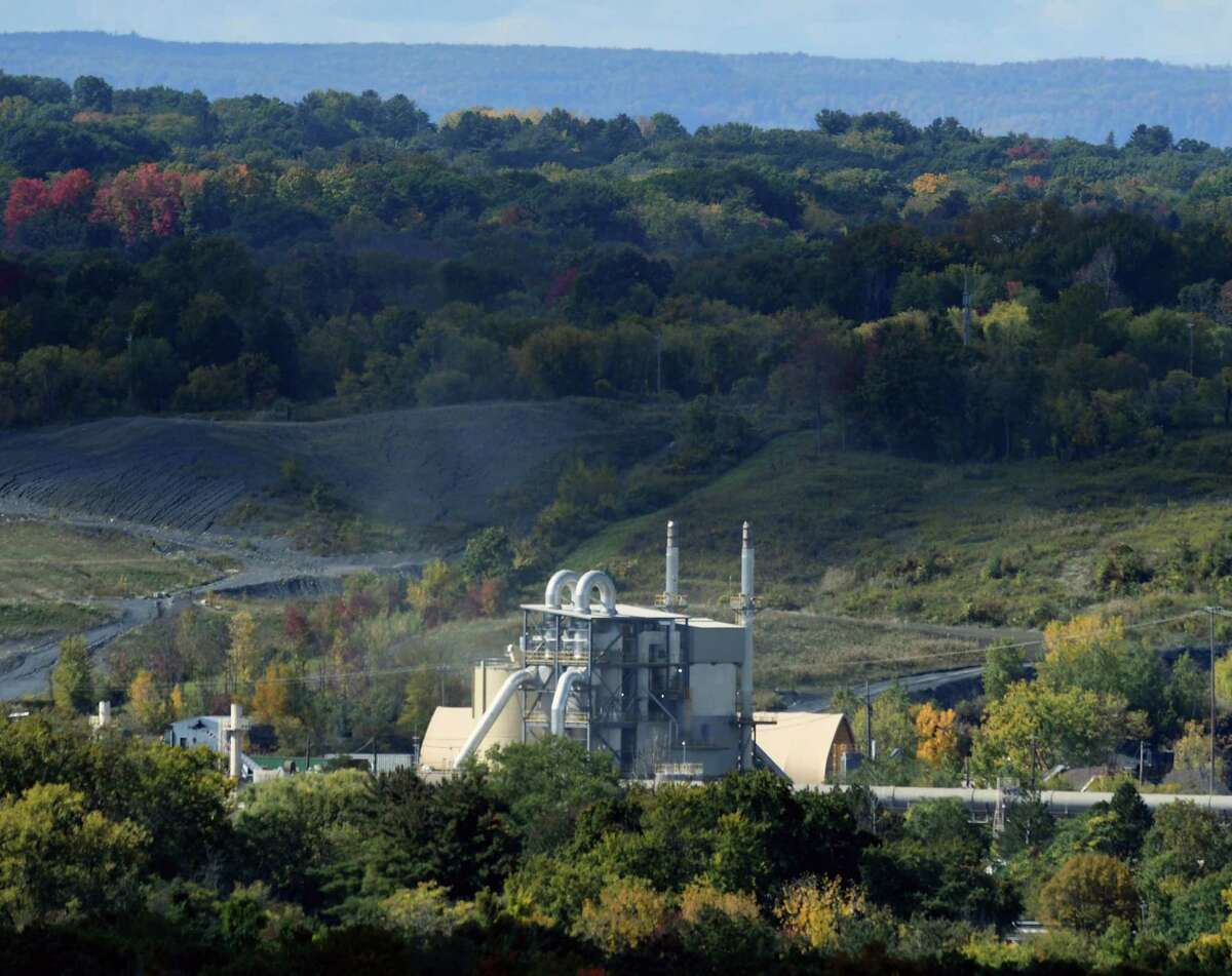 The Norlite aggregate plant is seen from Oakwood Cemetery on Thursday, Oct. 1, 2020, in Troy, N.Y. New York State DEC is collecting soil and water samples near the Cohoes facility to detect for PFAS contamination. (Will Waldron/Times Union)