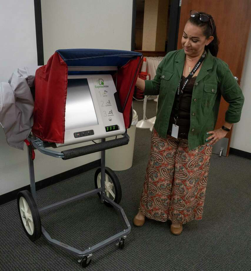Rosa Olgin, voter registrar, shows off the new curbside voting on mobile carts that will be available at all early voting centers 10/01/2020 as the Midland County Election Office readies for early voting to start. Midland County Election Office is preparing for early voting. Rosa Olgin, voter registrar, on Thursday showed off the new curbside voting on mobile carts that will be available at all early voting centers. Curbside voting will be available only for those with a disability that makes them unable to enter a polling location, according to the Texas Secretary of State's website. Voters must make a request with the Elections Office to vote curbside ahead of time and a ballot will be brought to their vehicle by an elections officer. Photo: Tim Fischer, Midland Reporter-Telegram