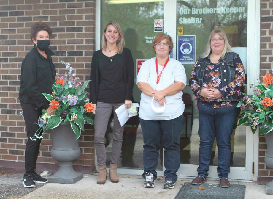 Staff members with Our Brothers Keeper Shelter for the Homeless in Big Rapids welcomed people to the shelter Thursday. The nonprofit organization opened this week after closing in June for renovations. (Pioneer photo/Taylor Fussman)