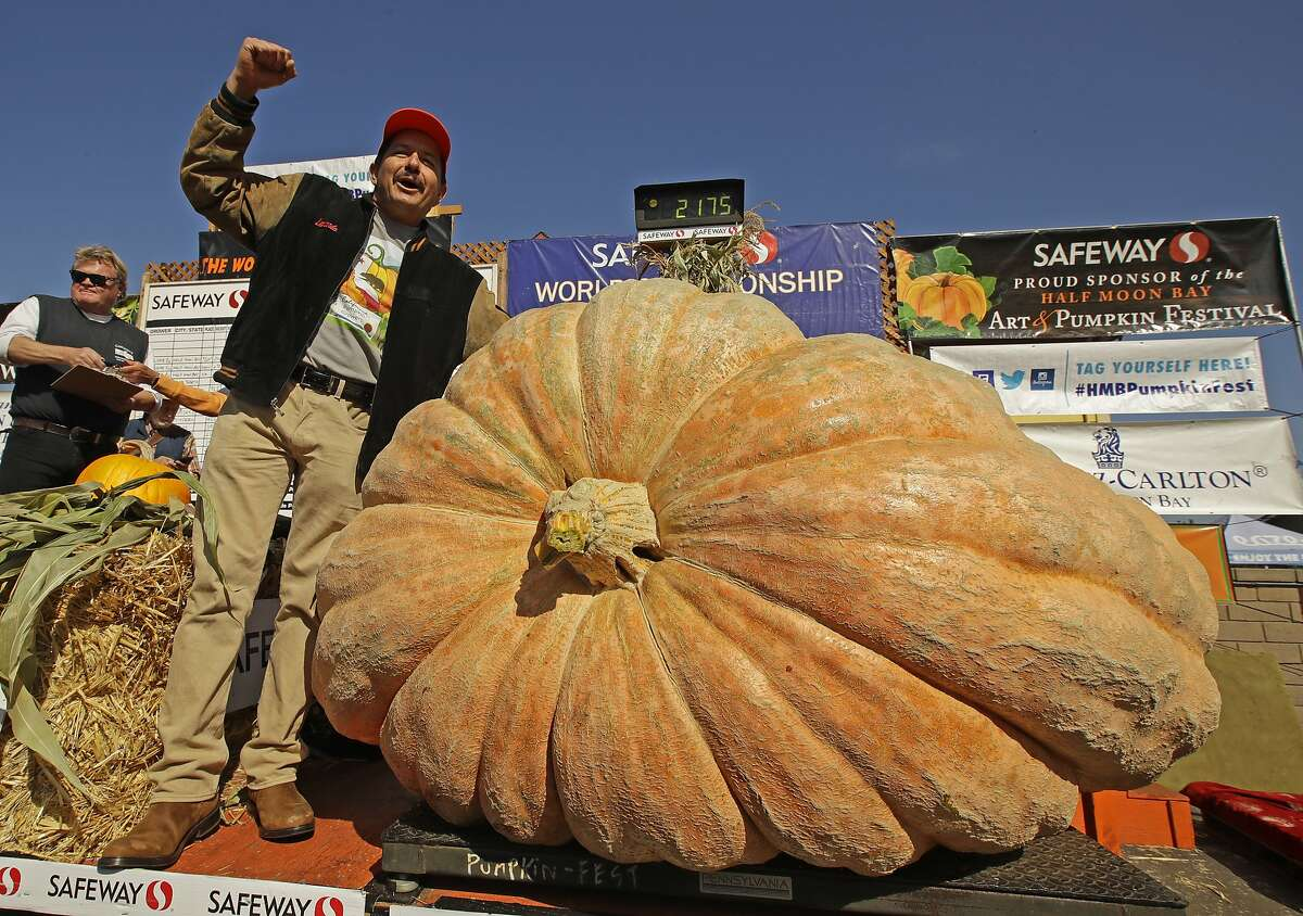 Leonardo Urena of Napa learns his pumpkin weighed in at 2,175 pounds, a new California weight record, at last year's pumpkin contest in Half Moon Bay.