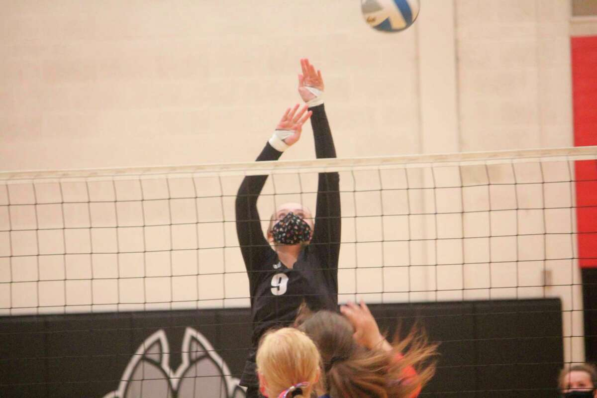 Christina Malackanich of Reed City goes up for the ball during recent action. (Pioneer photo/John Raffel)