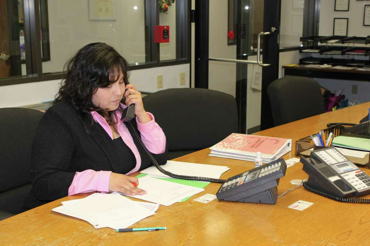 Volunteers answer calls made to the Family Violence Center hotline at Northwest Assistance Ministries.