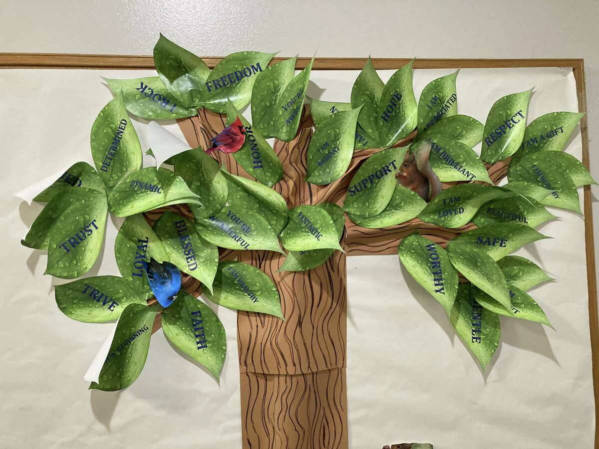 A tree with encouraging words is displayed at the Northwest Assistance Ministries Family Violence Center.