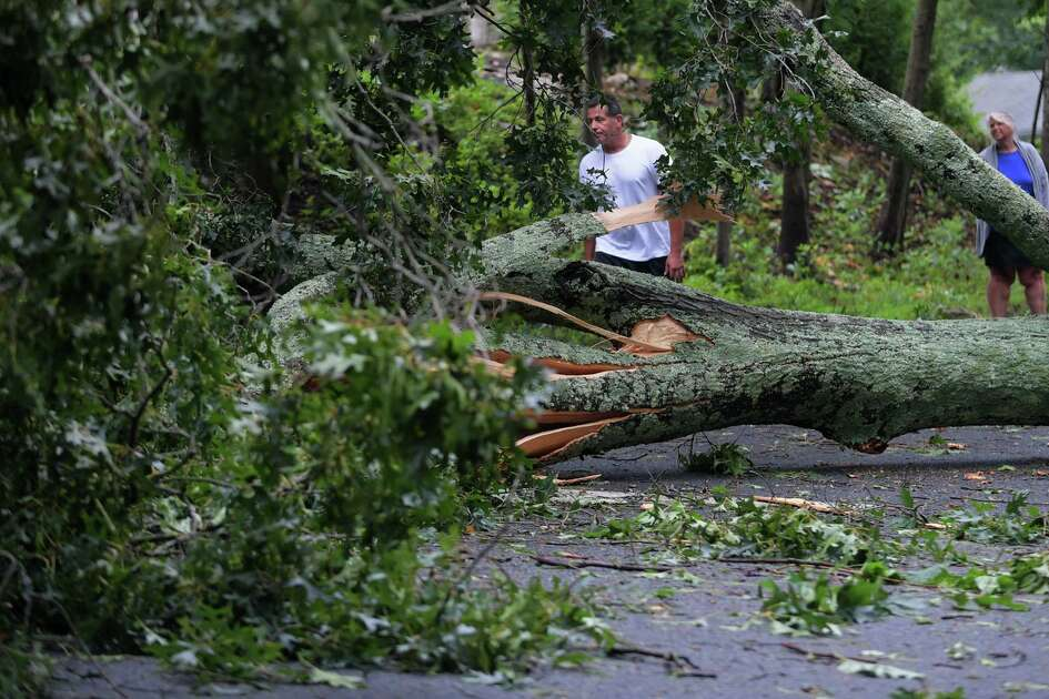 Residents looked at storm damage in Norwalk after the August tropical storm.